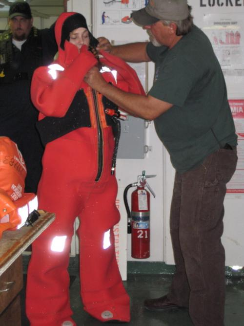 Undergraduate Mindy Ingebretson and Doug Beck demonstrating an Immersion Suit