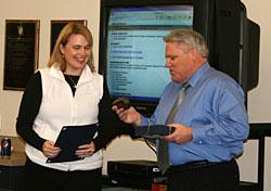 Wegner receives award from Jim Mabbott, ESD superintendent.