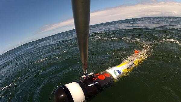 The AUV is retrieved from the Pacific Ocean after traveling through the mouth of the Columbia River.