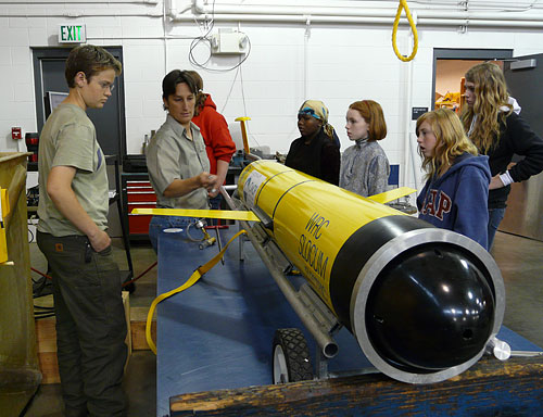 Katie Rathmell teaches a group of high school students about a glider named Phoebe